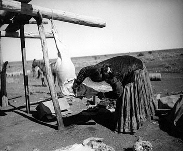 Navajo women butchering a sheep