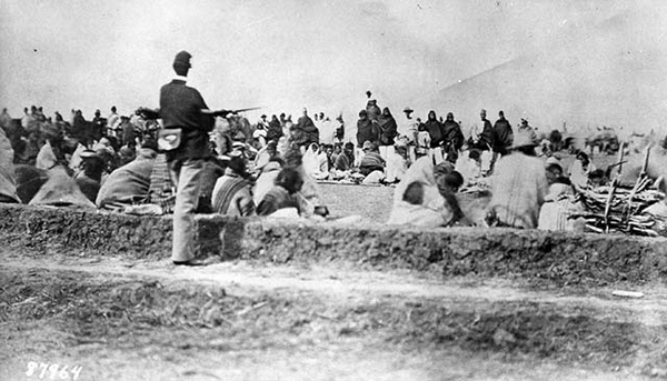 "Courtesy of the State Records Center and Archives. Frank McNitt Papers, Serial #5514; photo #5702. ""Navajos under guard at Fort Sumner,"" ca. 1864. U.S. Army Signal Corps Photo in the National Archives."